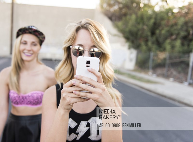 Young Woman Taking a Selfie on Street