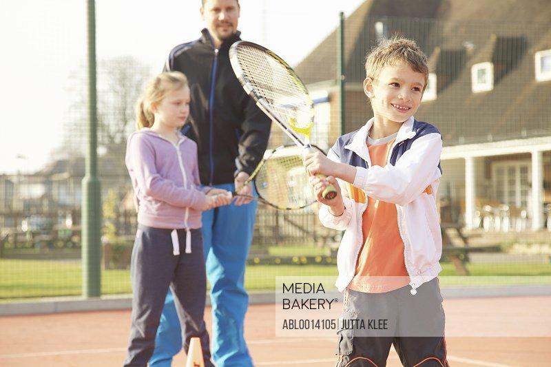 Children Practicing Tennis