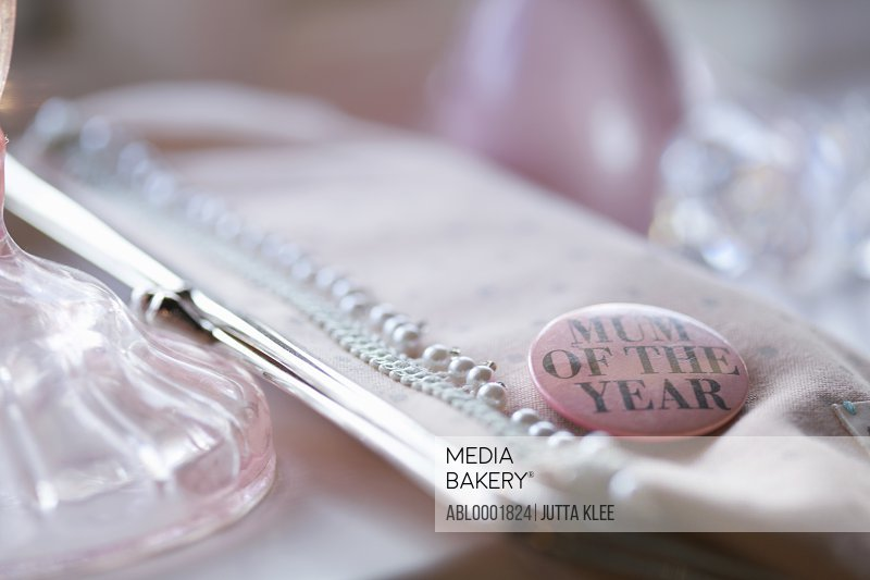 Clutch bag with a 'mum of the year' badge