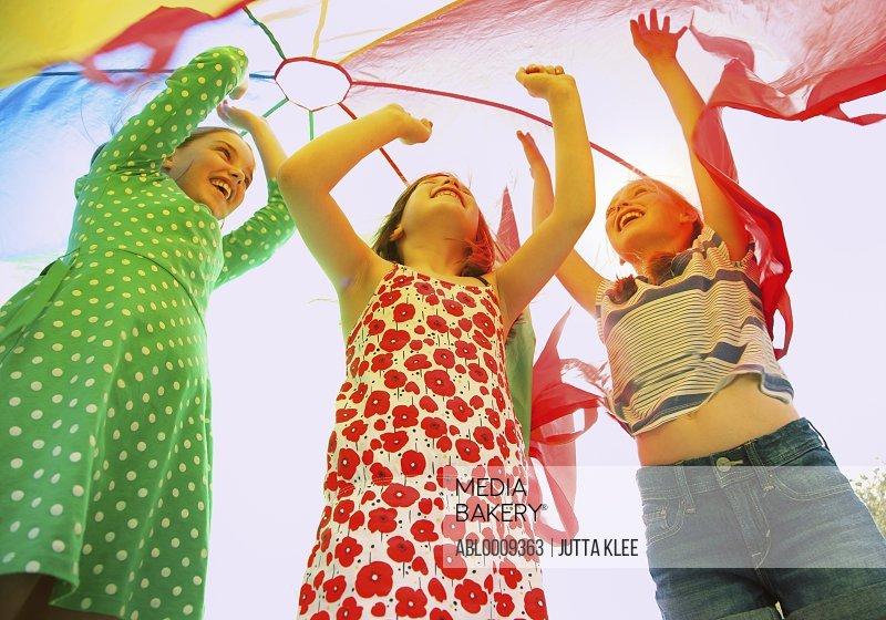 Children Playing under Parachute