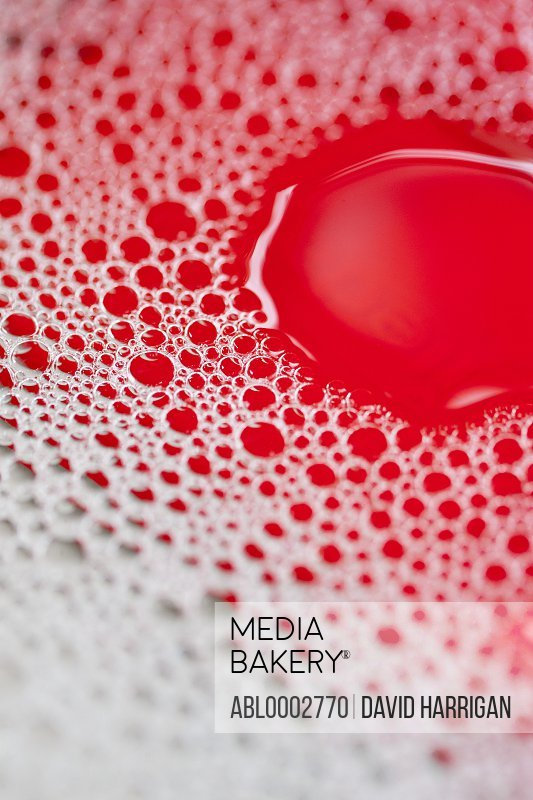 Close up of red bubbly dishwashing detergent