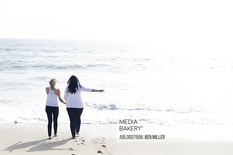 Back View of Two Women Walking on Beach