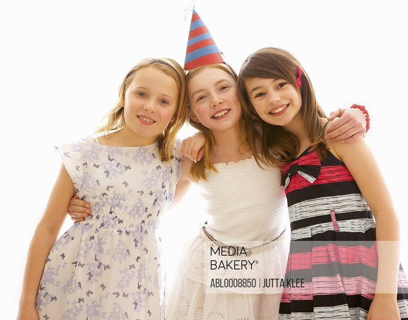 Portrait of Three Young Girls at Party