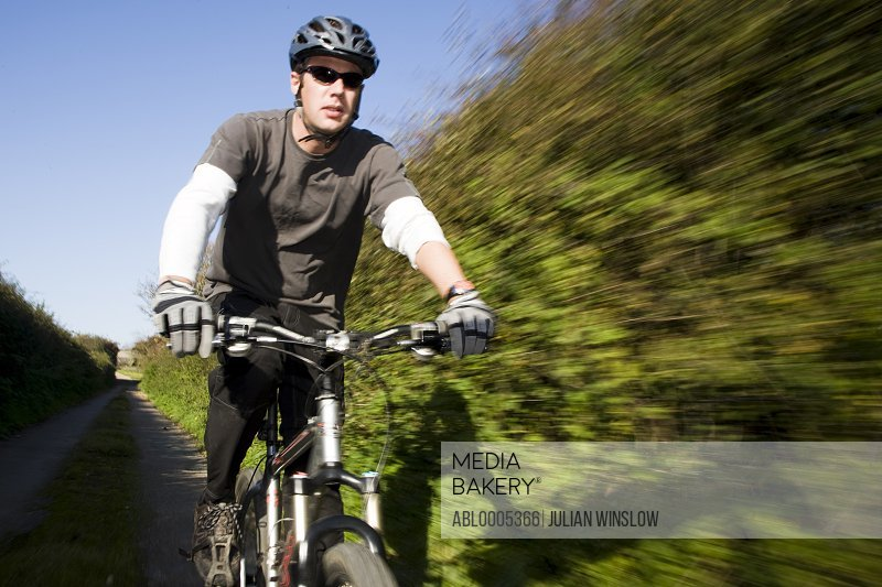 Man cycling on a country road
