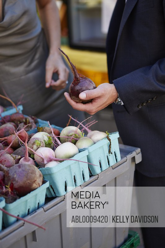 Man's Hand Holding Red Beet