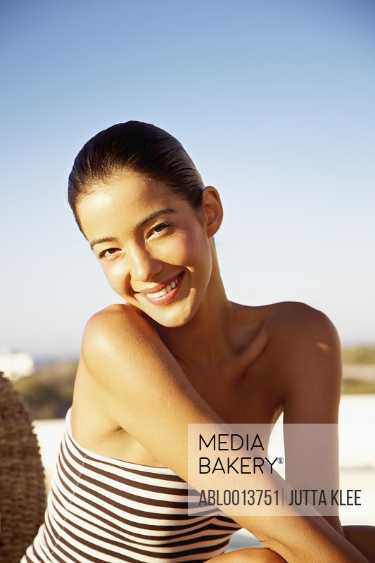 Smiling Young Woman Wearing Strapless Bathing Suit