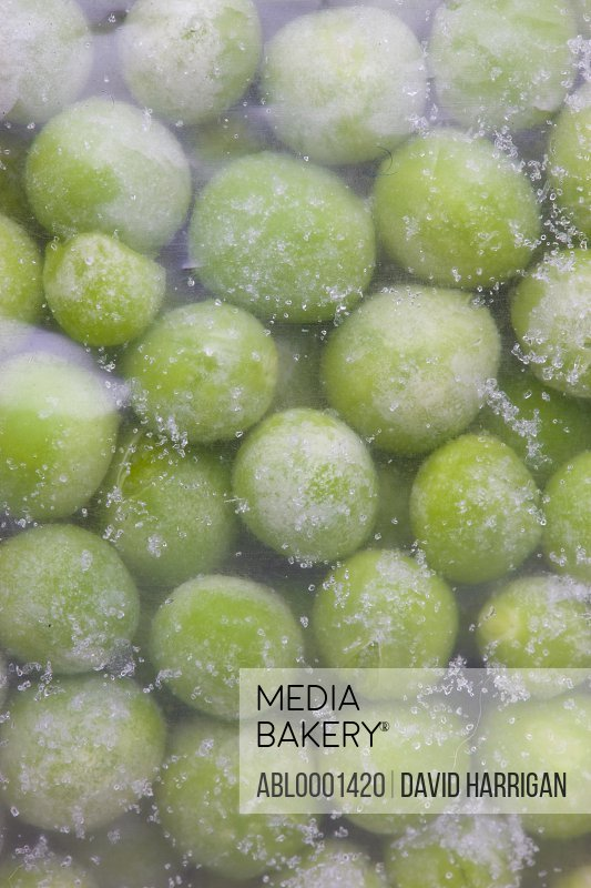 Extreme close up of a freezer bag filled with frozen peas