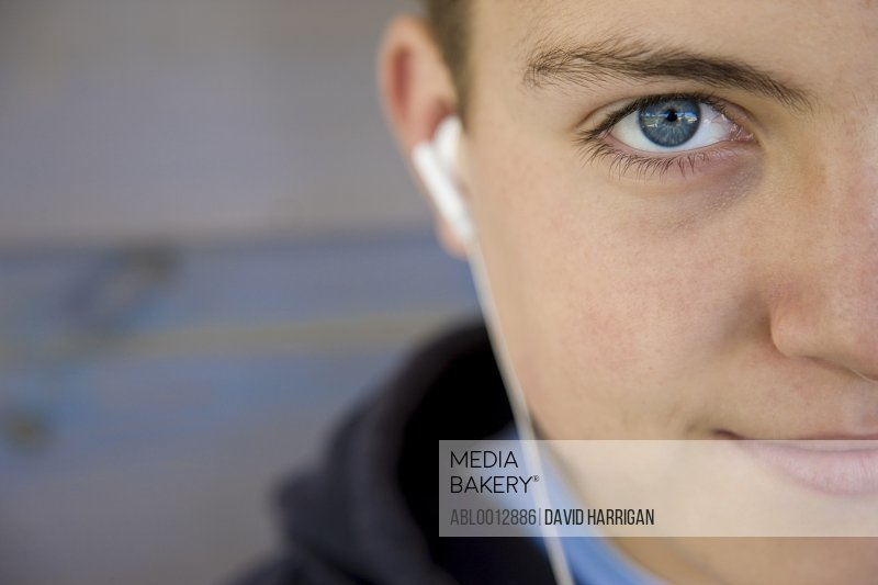 Extreme close up of a boy wearing earphones