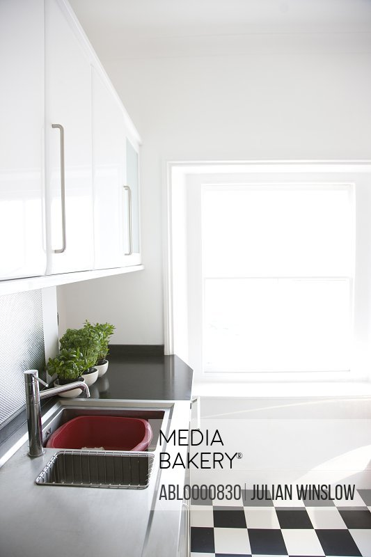 Empty kitchen with black and white floor
