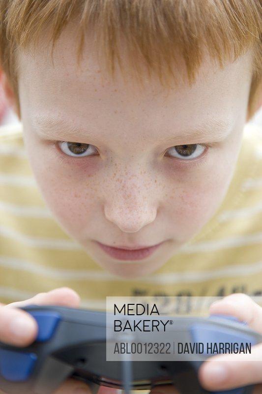 Boy holding a game controller