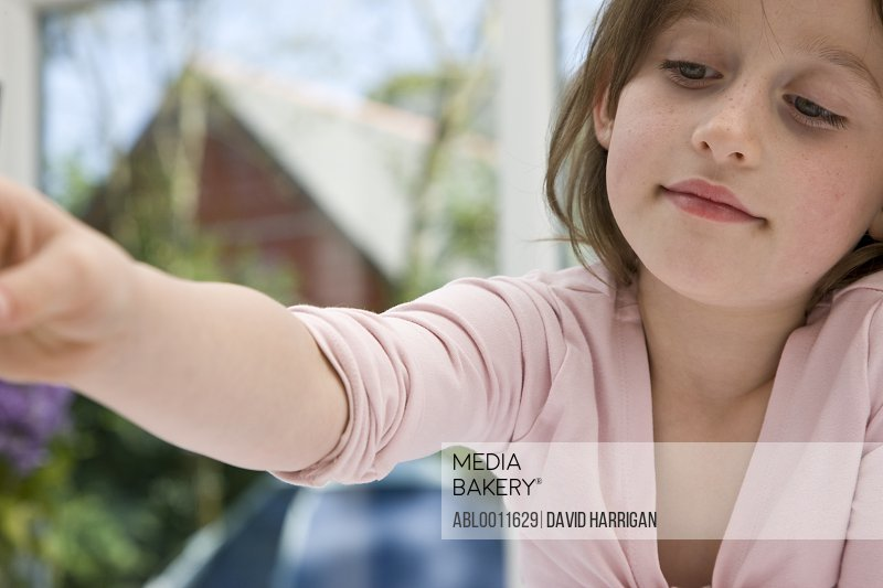 Young girl with arm extended