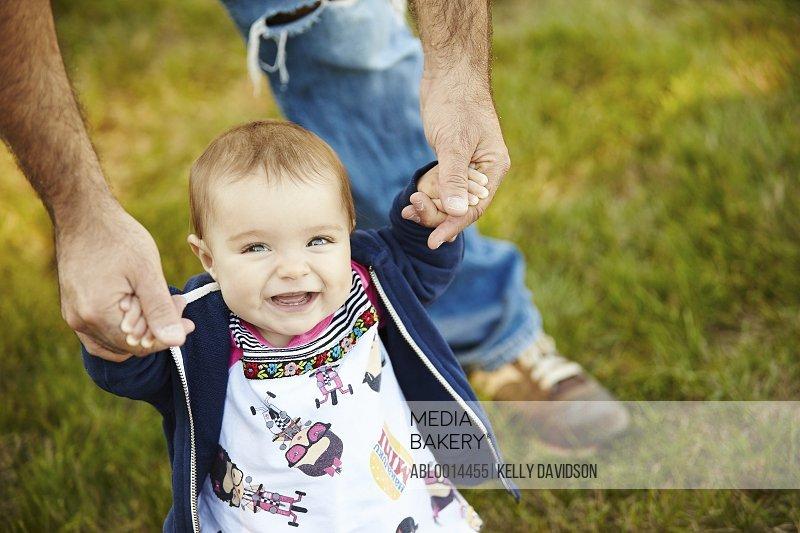 Baby Girl Taking First Steps in Garden