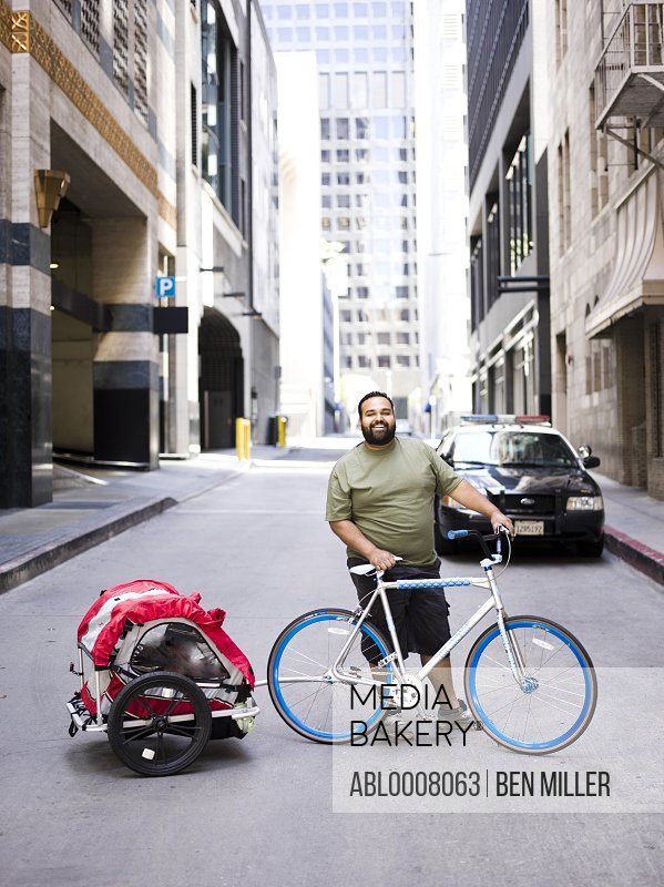 Man with Bicycle and Trailer
