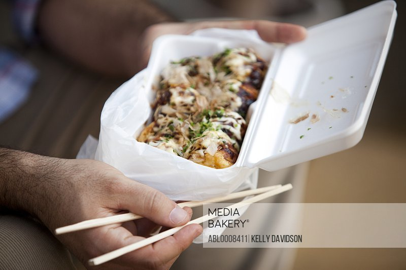 Man Eating Takoyaki, Close-up View