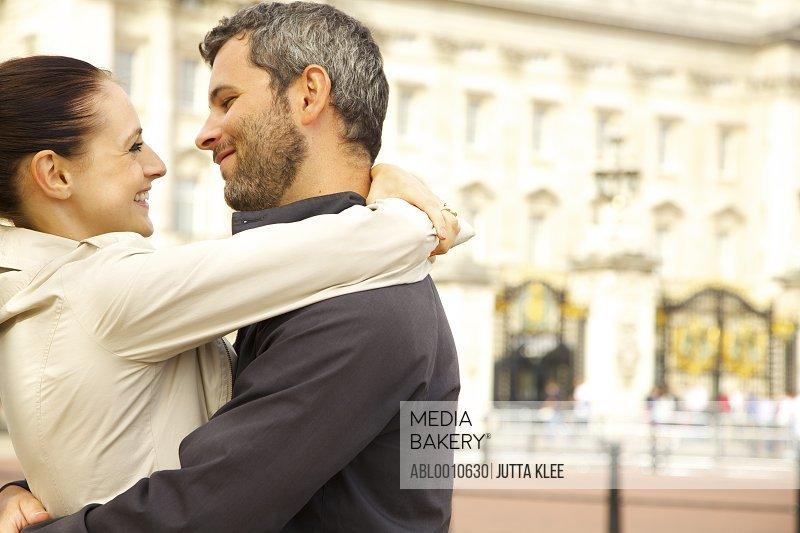 Couple Embracing Outside Buckingham Palace, London, England