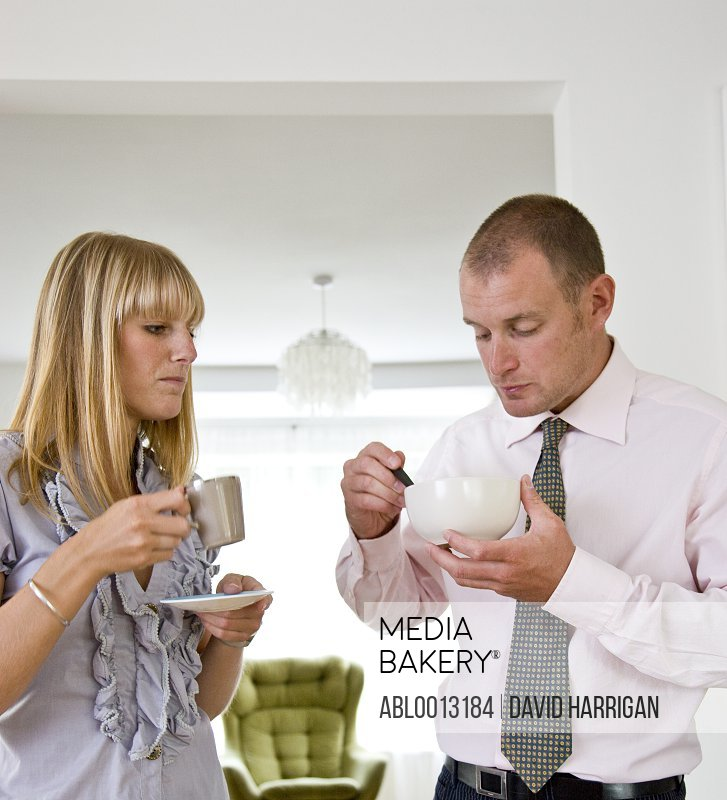 Couple Having Breakfast Standing