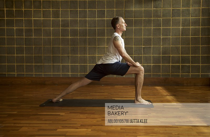 Mature Man Practicing Yoga