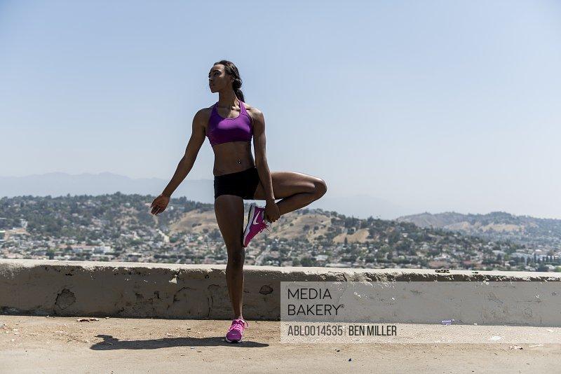 Sportswoman Standing on one leg Outdoors