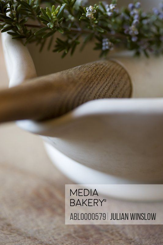 Close up of mortar and pestle with rosemary