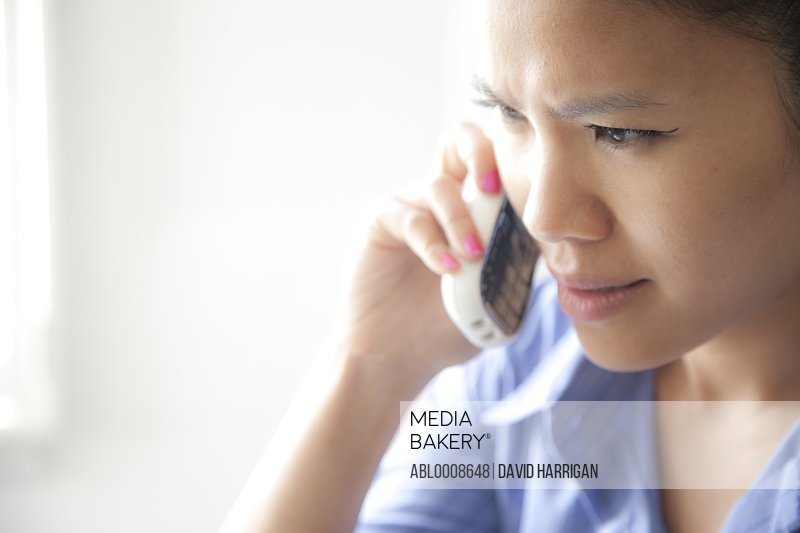 Woman Using Telephone, Close-up View