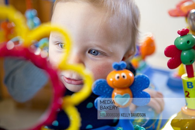 Baby Girl Playing with Colourful Toys
