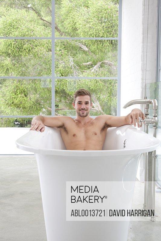 Smiling Man in Bathtub