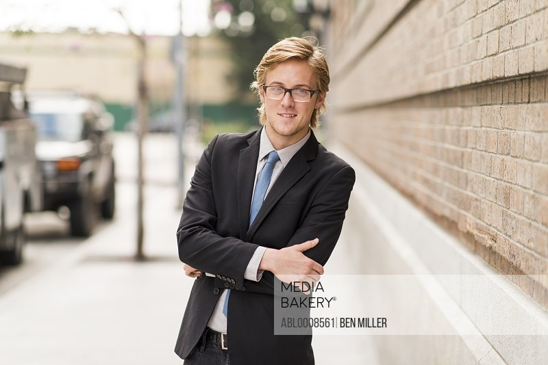 Businessman on Street with Arms Crossed