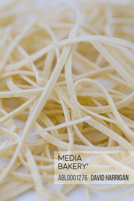 Extreme close up of fresh egg pasta tagliatelle
