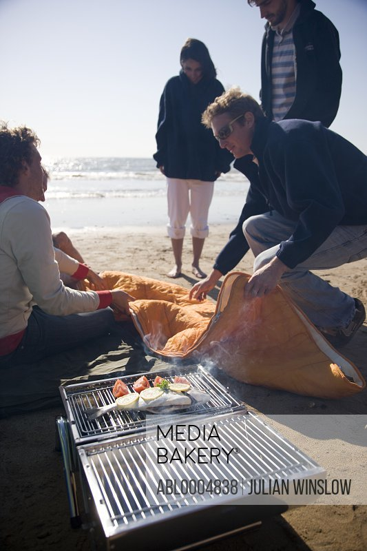 Friends having a barbeque on the beach