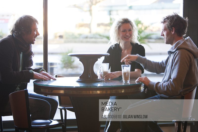 Group of friends sitting in a cafe talking