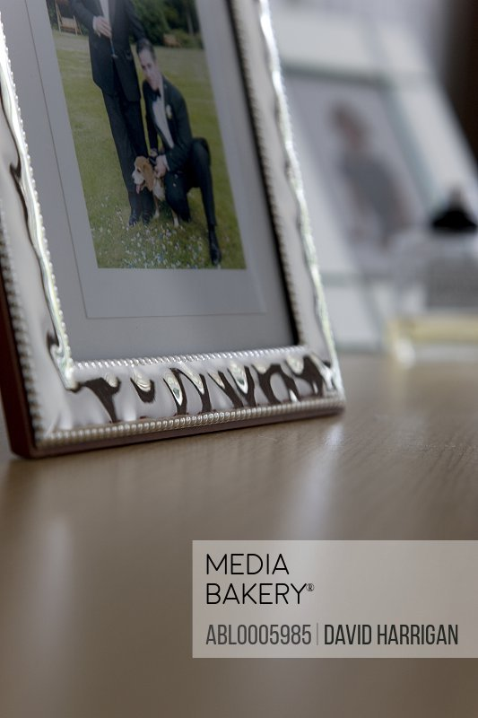 Close up of a silver framed photo on a shelf
