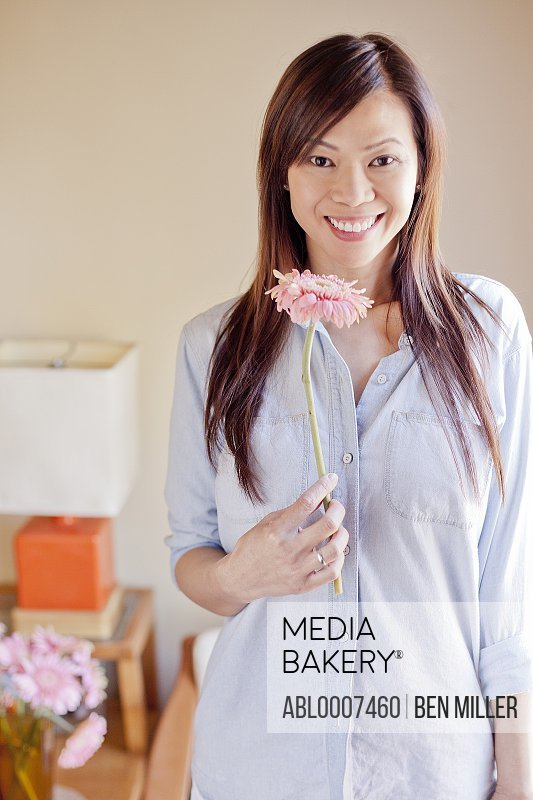 Smiling Woman Holding Flower