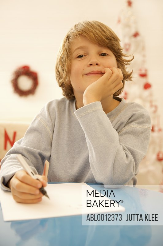 Boy writing a letter to Father Christmas