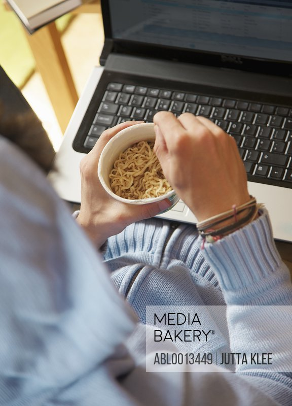 Man Using Laptop whilst Eating, Close up view, High angle view