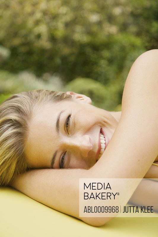 Close up of Woman Lying Down Smiling