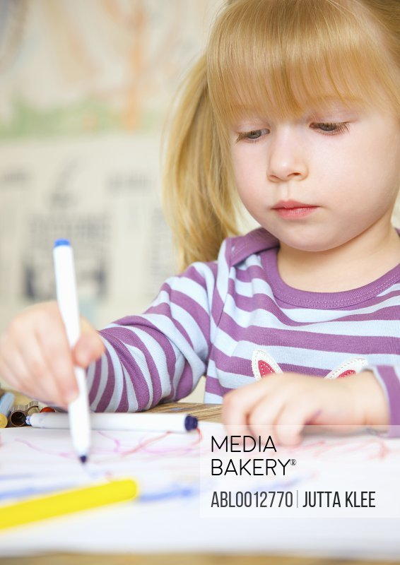 Girl drawing and coloring
