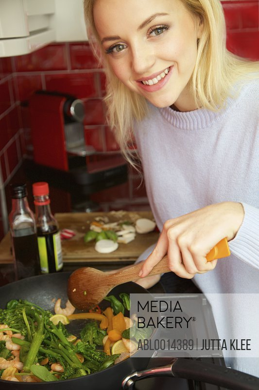 Smiling Woman Cooking Stir Fry