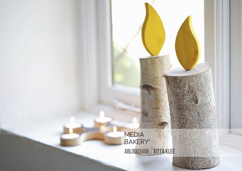 Handmade Decorative Candles on Window Sill