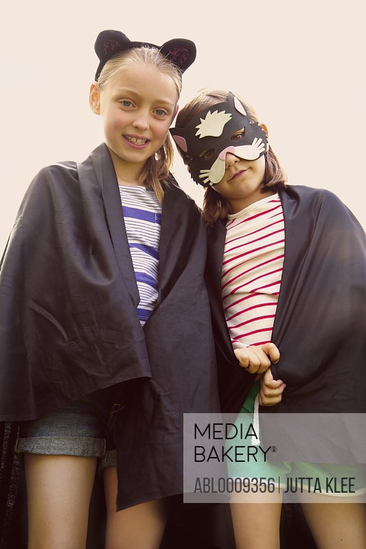 Young Girls Wearing Cape and Mask