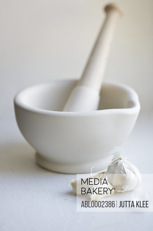 Mortar and Pestle with Garlic Cloves