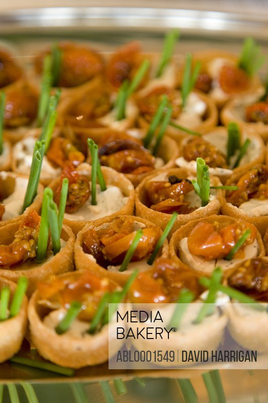 Close up of sun dried tomatoes and chives canapés