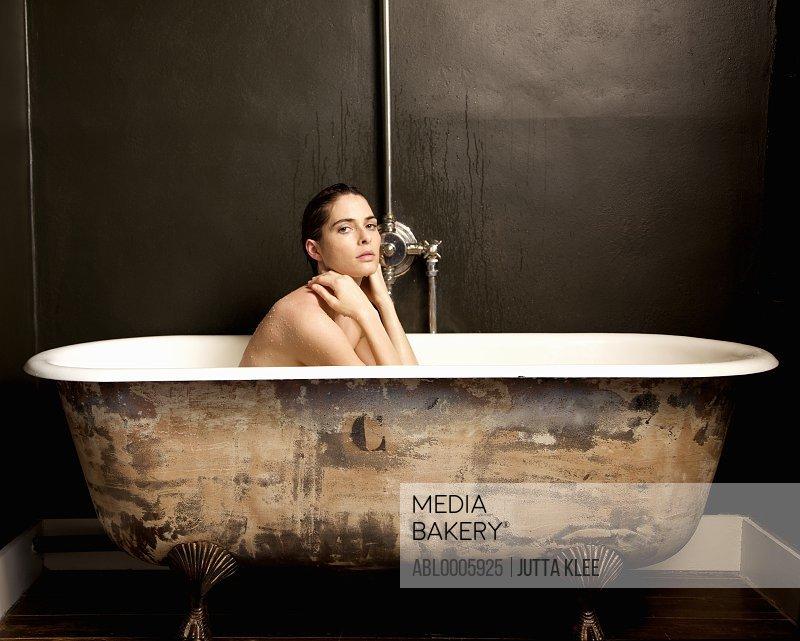 Portrait of a woman taking a bath