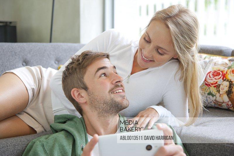 Couple on Sofa Using Smartphone