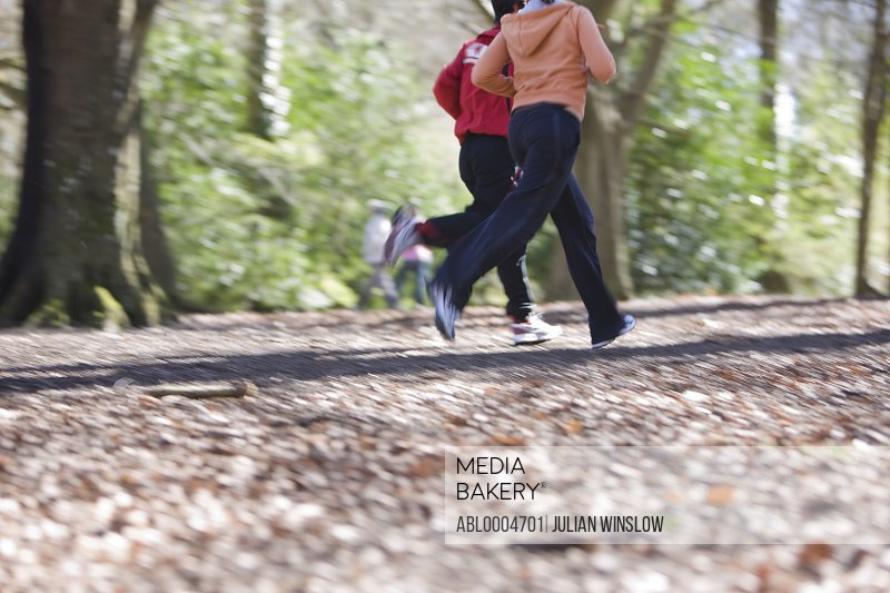 Portrait of two people running in the park