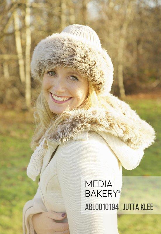 Woman Wearing Fur Trim Hat Outdoors