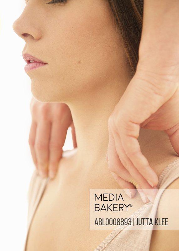 Woman Receiving a Thai Yoga Massage, Close-up View