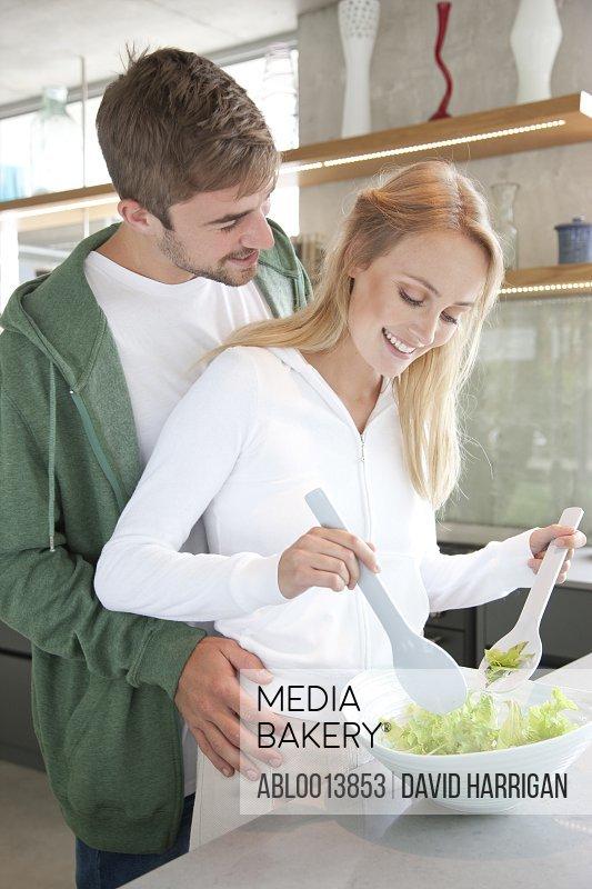 Young Couple Preparing Salad