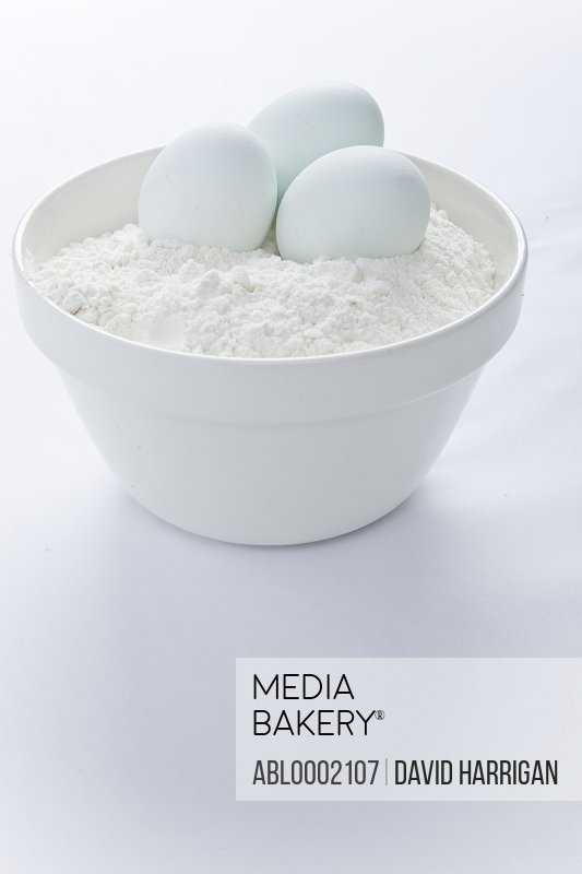 Mixing Bowl with Eggs and Flour