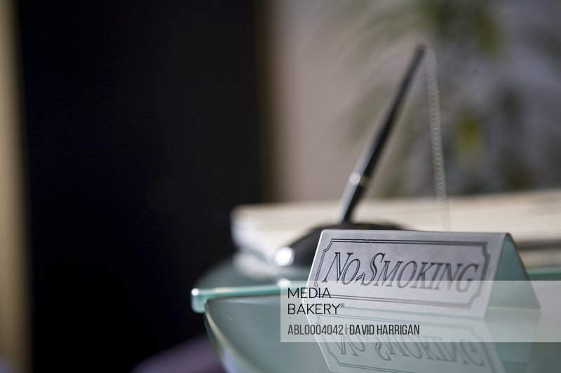 Close up of no smoking sign on glass desk