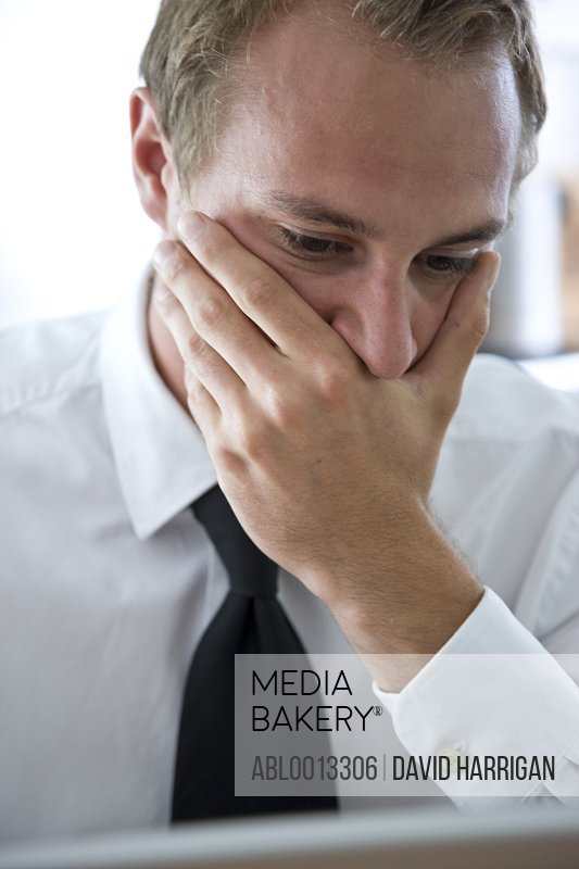 Close up of Businessman with Hand Covering Mouth